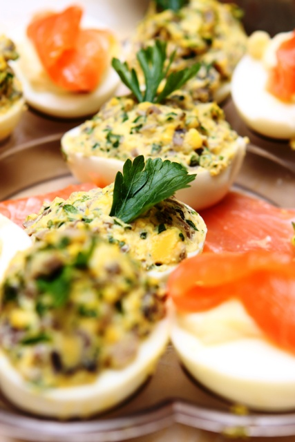 stuffed eggs with pesto and salmon