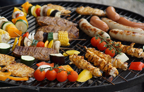 Different foods on an outdoor grill