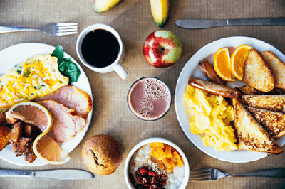 breakfast menu dishes with omelets, french toast and fruit