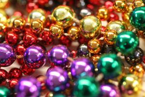 Mardi Gras beads thrown from parade floats.