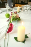 table setting with candle and rose